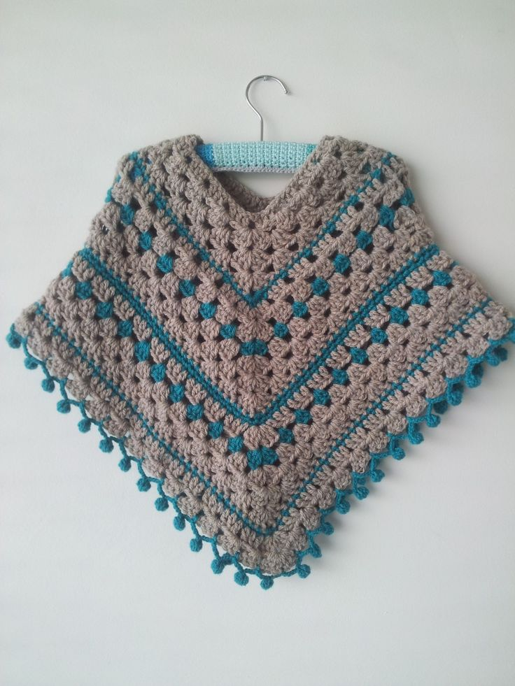 Kinderponcho via Aan de haak. Click on the image to see more!