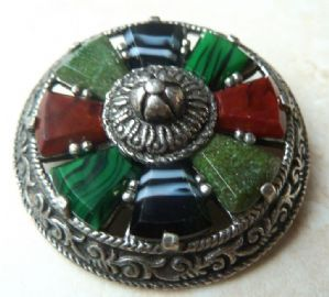 Stunning vintage Celtic style shield brooch  manufactured by Miracle a designer jewellery brand of  A Hill and company Ltd.  The brooch has a Celtic shield design set with a series of faux gem stones set in silver tone metal.  ( Including faux marble, carnelian, agate and malachite ) Circa 1970's.  Signed Miracle to the back of the brooch.