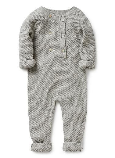 100% cotton knitted jumpsuit with front  placket opening and inner leg snaps. Features front buttons and rib cuffs