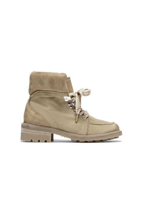 Boot in fabric and cow suede. Laces for closure.  Boot with a heavy thermoplastic rubber sole.  Handcrafted in Portugal.