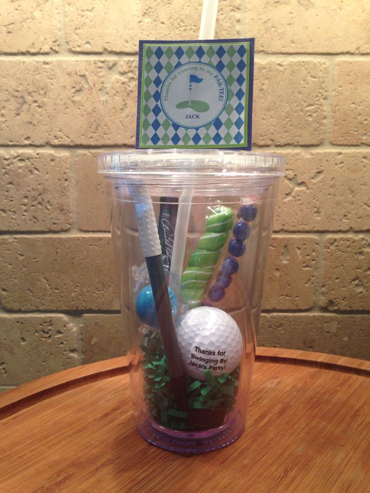 Golf Party Favors: green 'grass' with a golf pen, personalized golf ball, candy and a Arnold Palmer 'half & half' powder drink serving!