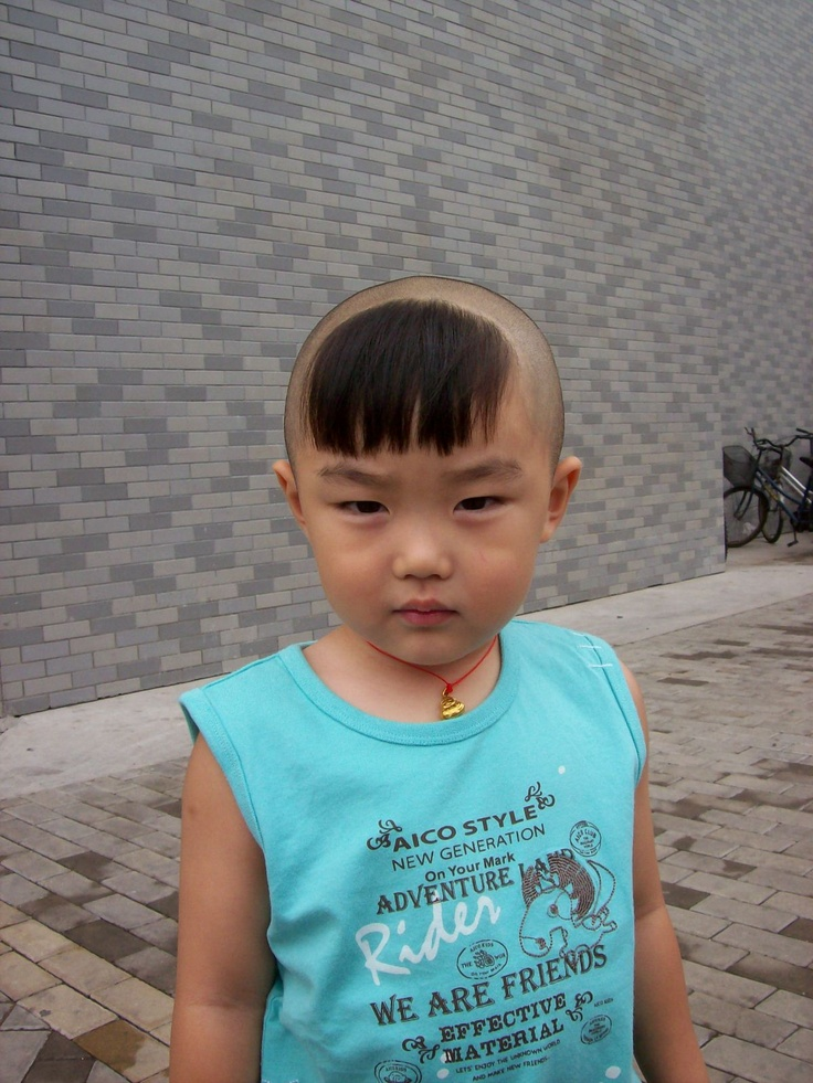 young boys haircut in China...you can't see the tiny ...
