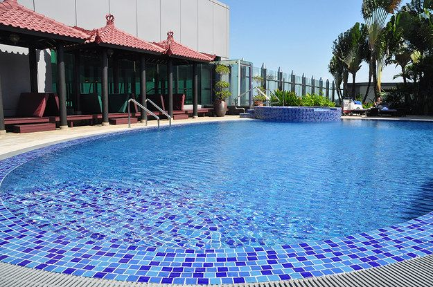 Lie in the sun and go for a swim in the rooftop pool. | 18 Things You Didn't Know You Can Do At Changi Airport