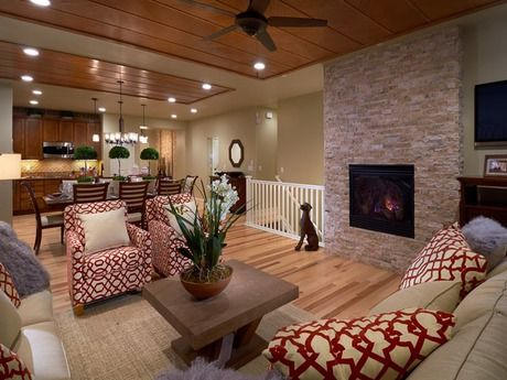 A Stacked Stone Fireplace And Light And Dark Wood Flooring