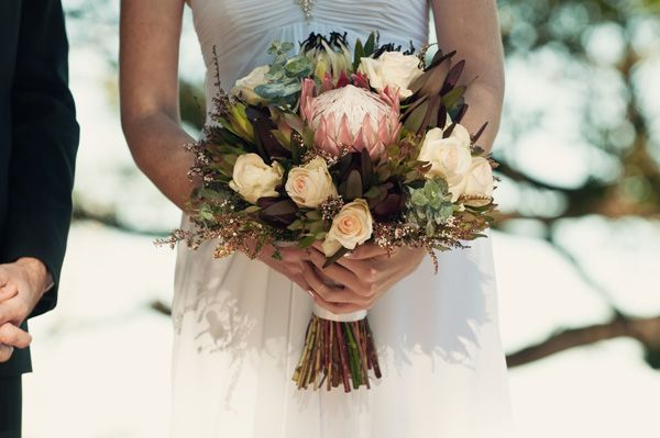 native bouquets.  Soft peachy roses mixed in with Australians.  Classic & elegant with a local twist.    Source: http://amouramour.com.au/2011/06/polka-bouquets/