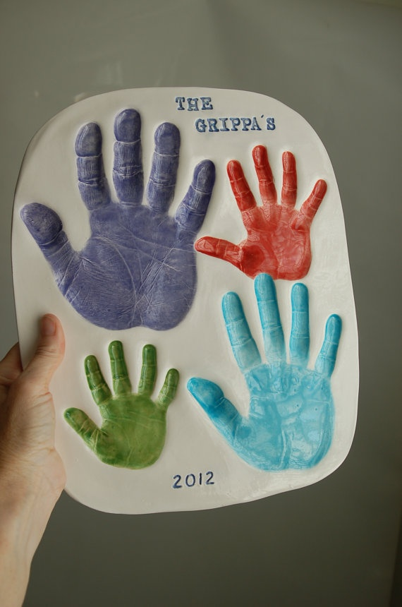 Hand prints of the family with four hands and includes molds. $160.00, via Etsy.