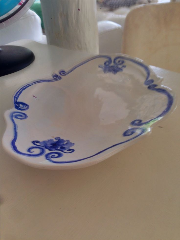 Hand designed, crafted and painted in Cape Town. Ceramic server.