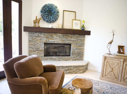 stone veneer fireplace with rustic wood mantle