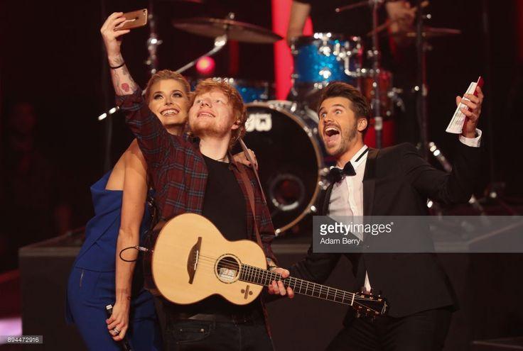 Lena Gercke, Ed Sheeran and Thore Schoelermann take a selfie during the 'The Voice of Germany' finals at Studio Berlin Adlershof on December 17, 2017 in Berlin, Germany.