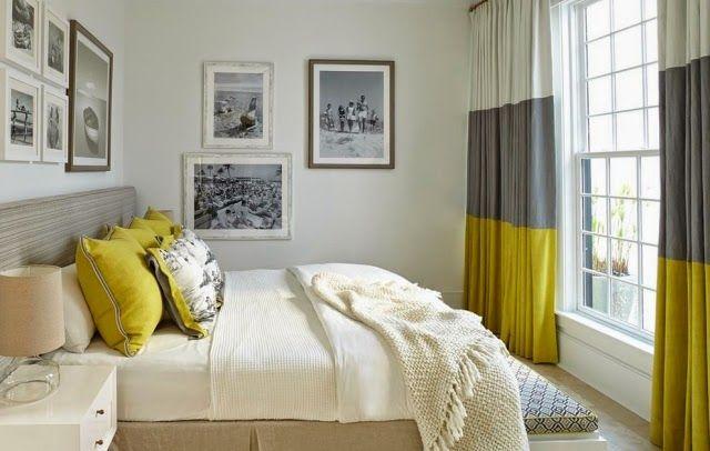 une belle chambre à coucher en jaune, gris clair et blanc