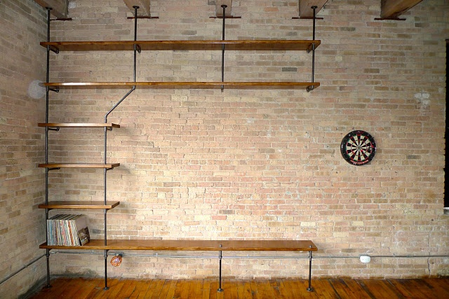 1.Brick on fireplace wall   2.Pipe shelving around fireplace and TV