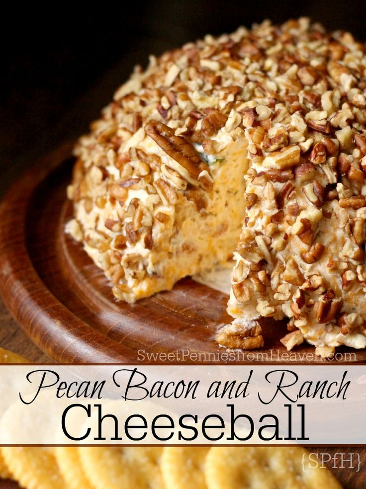 This delicious Pecan Bacon and Ranch Cheeseball Recipe is one for the books! It's one of the best cheesy appetizers I've had in quite awhile. Perfect to serve as a New Year's Eve appetizer or as game night foods with other snacks. Filled with cheddar, cream cheese, bacon, and more then rolled in pecan chips. YUM!!