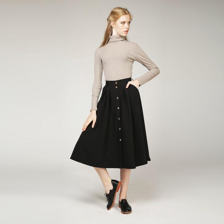ЮБКА А-СИЛУЭТА «THE ONLY GIVE» имеет глубокий черный цвет, А-образный силуэт заметно уменьшает талию, золотые пуговицы. Состав: 95% полиэстер, 5 % эластан. #платье  #мода #стиль #украина #сестры-дизайнеры #плиссировка #классика #бренд #свободный крой #красота #Fashion #style #beauty   #воланы #платье #хлопок #umm   #мода #baby doll #черный #А-силует #юбка #пуговицы #umm