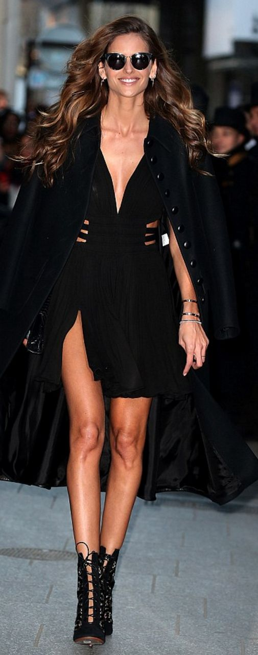 Who made Izabel Goulart's lace up ankle boots and plunge dress?