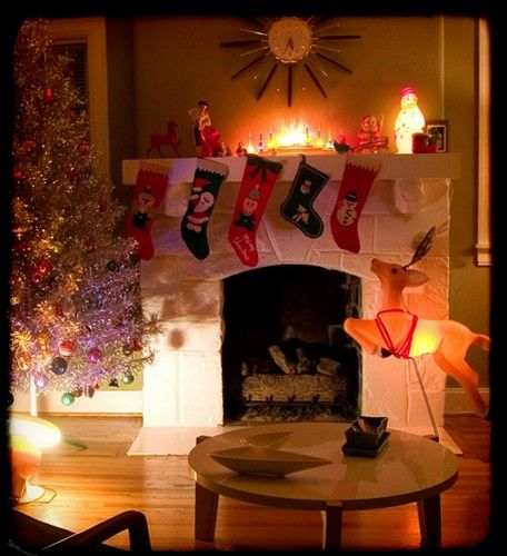 Mid-century style Christmas. Aluminum tree. Glowing reindeer