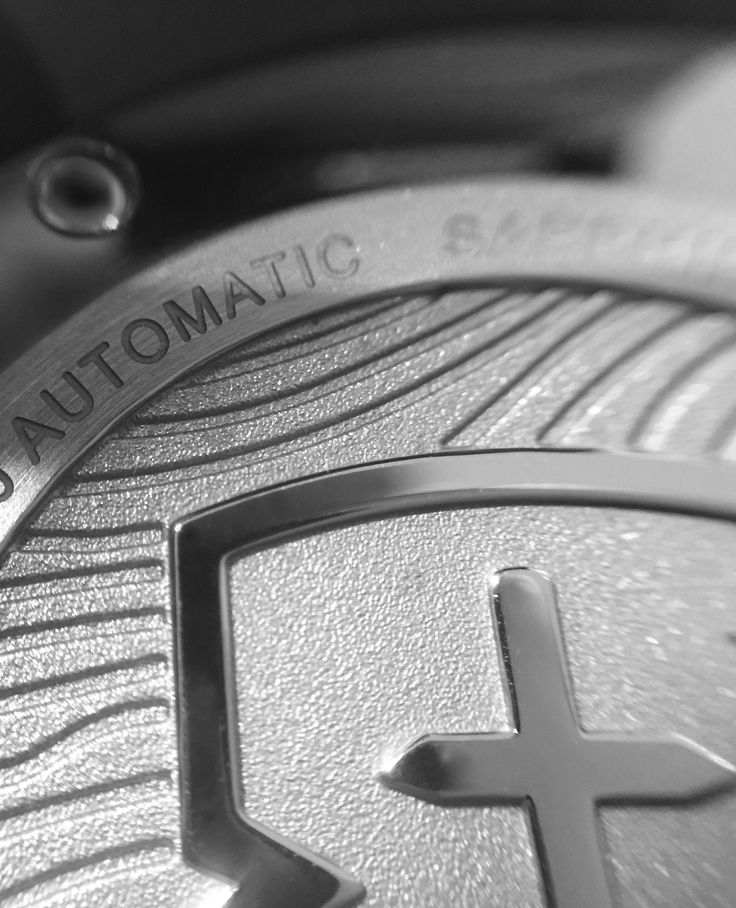The steel caseback version of the Tyneham automatic features contour lines hand-drawn from an Ordnance Survey map overlaid with the EB shield.