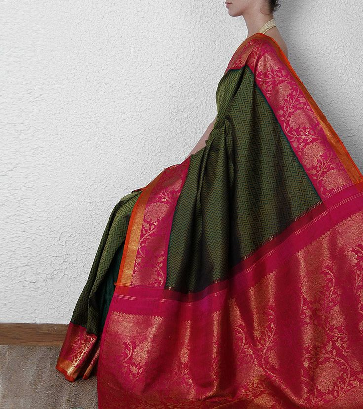 Green Kanjivaram Saree with Zari work - I love this color combination and the green zigzags on the body