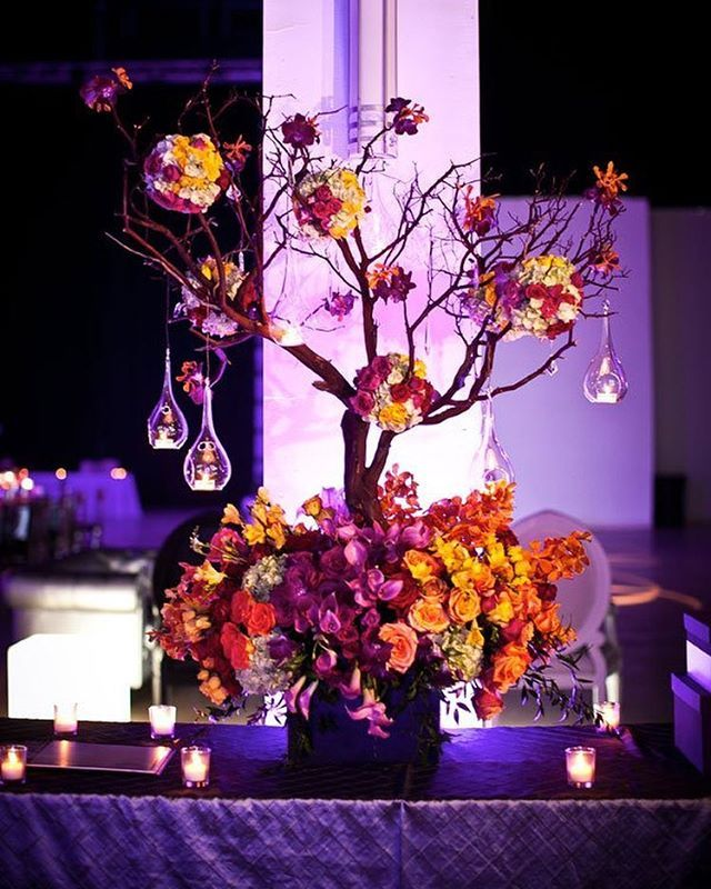 Flowers, branches, and baubles come together beautifully in this unique fall centerpiece!  : Steve Ramos Photo