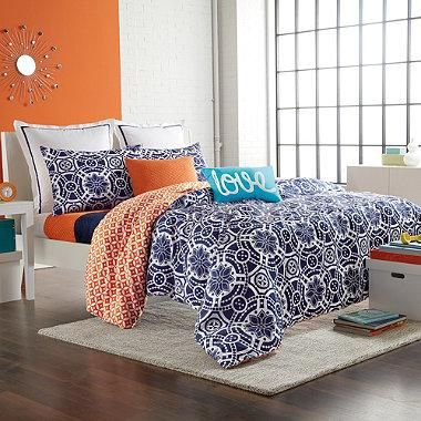 The Kayla duvet cover brings a variety of exciting styles into your bedroom. It has a crisp navy and white medallion top that reverses to an orange geometric pattern for a beautiful and stylish blend of patterns and colors.