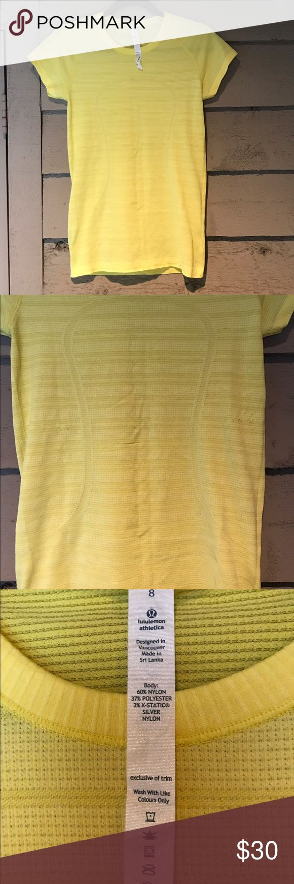 Lululemon Swiftly Tech ShortSleeve Neon Yellow Top This breathable and lightweight lululemon top is fabulous! It's a neon yellow and has a large lululemon logo on the front. There is some minor pilling on the shirt but overall it's in good condition. lululemon athletica Tops