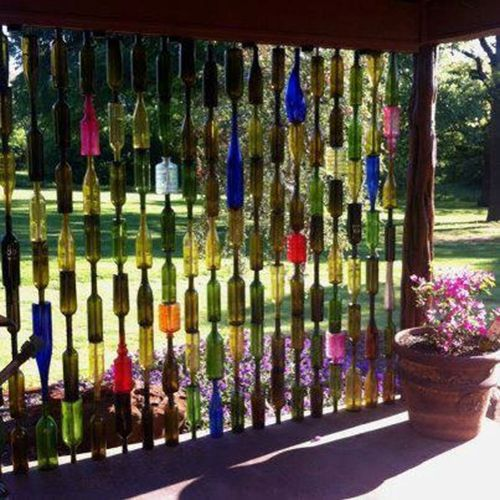 Wine bottle partition - nice touch to patio.  Drill hole in bottom of bottles then feed through lengths of rebar.