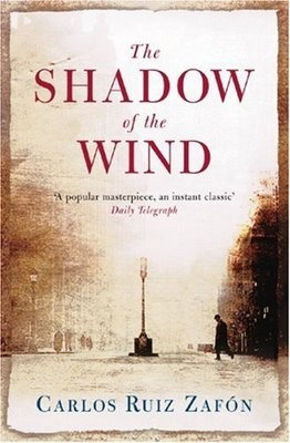Shadow of the Wind - Carlos Ruiz Zafon is a beautiful read with amazing language and a 1930's Barcelona Gothic setting.