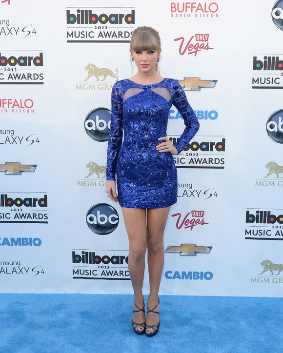 Taylor Swift looks stunning in this navy Zuhair Murad minidress.
