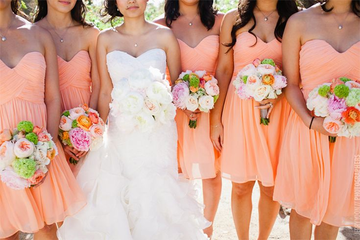 Sweetheart bridesmaids dresses in peach.