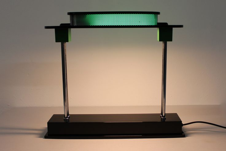 PAUSIANA Ettore Sottsass production Artemide, 1982  Table lamp of architectural form. Structure in polyurethane resin and chrome metal, acrylic diffuser.  Dimensions: W 48 cm / H 43 cm  / D 11 cm