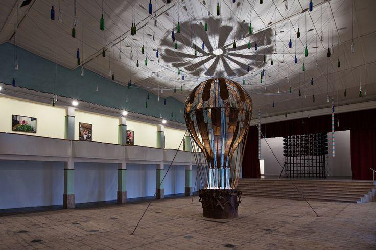 Nari Ward, Beyond, 2013, balloon, metal, glass bottles, ropes, paper. Galleria Continua San Gimignano, 2013. Photo by: Ela Bialkowska.