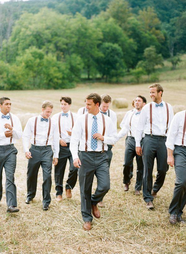Groomsmen with braces walking in a field