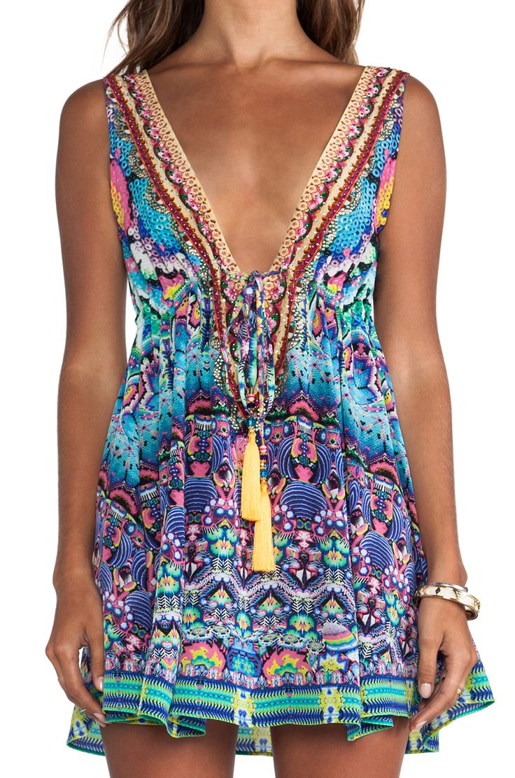 Love the colors.  You could wear this as a cover up or with a bikini top or tank underneath as a dress