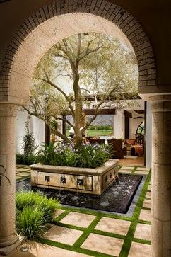 This is just too lovely for words. Courtyard water feature with olive tree and landscaping. Fireplace and seating