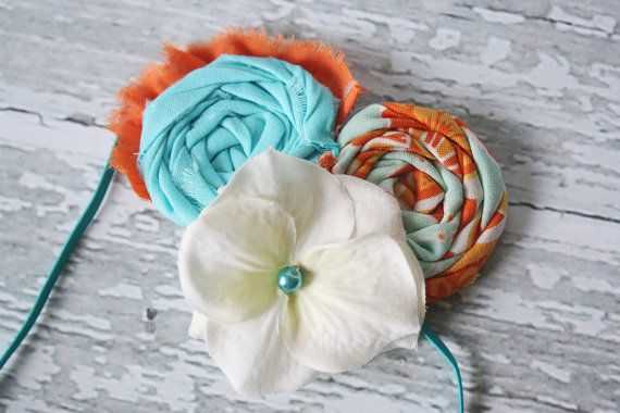 Lala needs this!  Citrus Twist orange and teal rosette and by babybirdieboutique, $13.50
