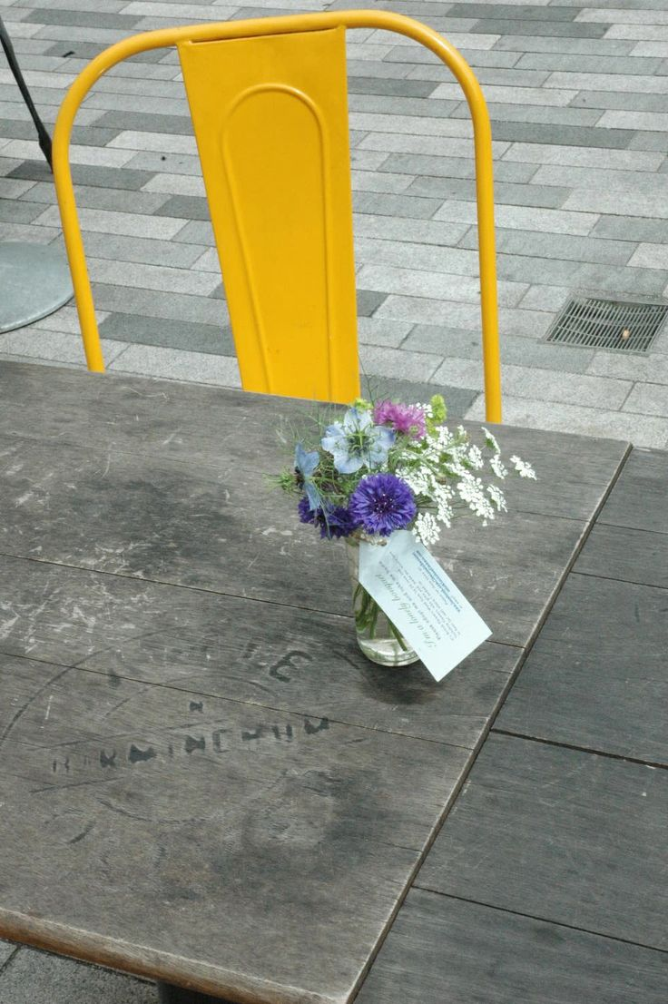 A Lonely Bouquet by Tuckshop Flowers comes to rest on an outdoor table in Birmingham for British Flowers Week 2014,