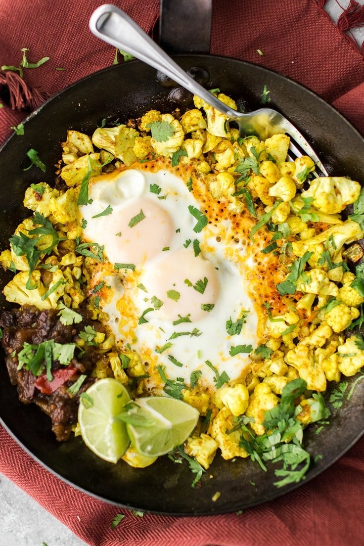 Spices and zesty flavors like turmeric, lime juice, ginger, and cayenne pepper are an easy way to add punch to this Turmeric Cauliflower Egg Skillet.