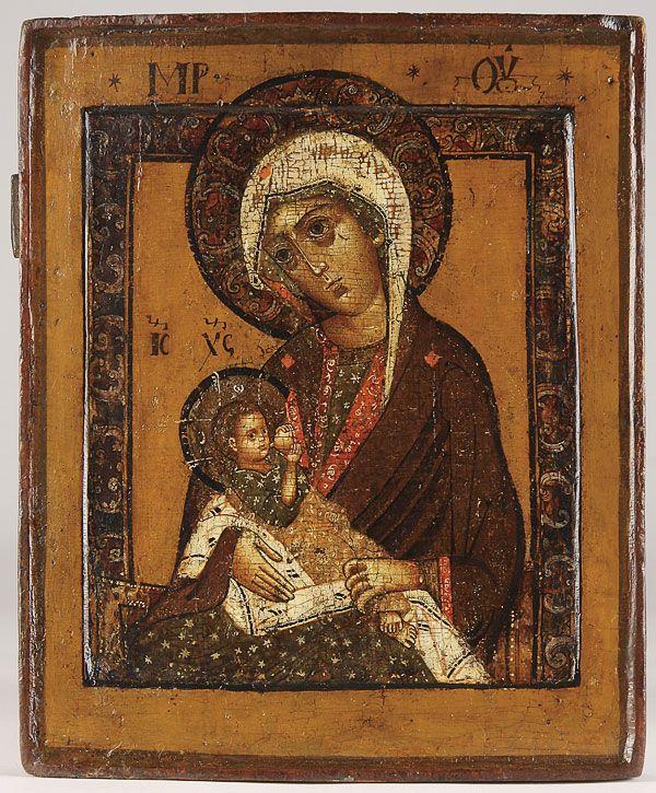 A FINE RUSSIAN ICON OF THE MLEKOPITATELNITSA MOTHER OF GOD, 17TH CENTURY.     Price realized $7,800