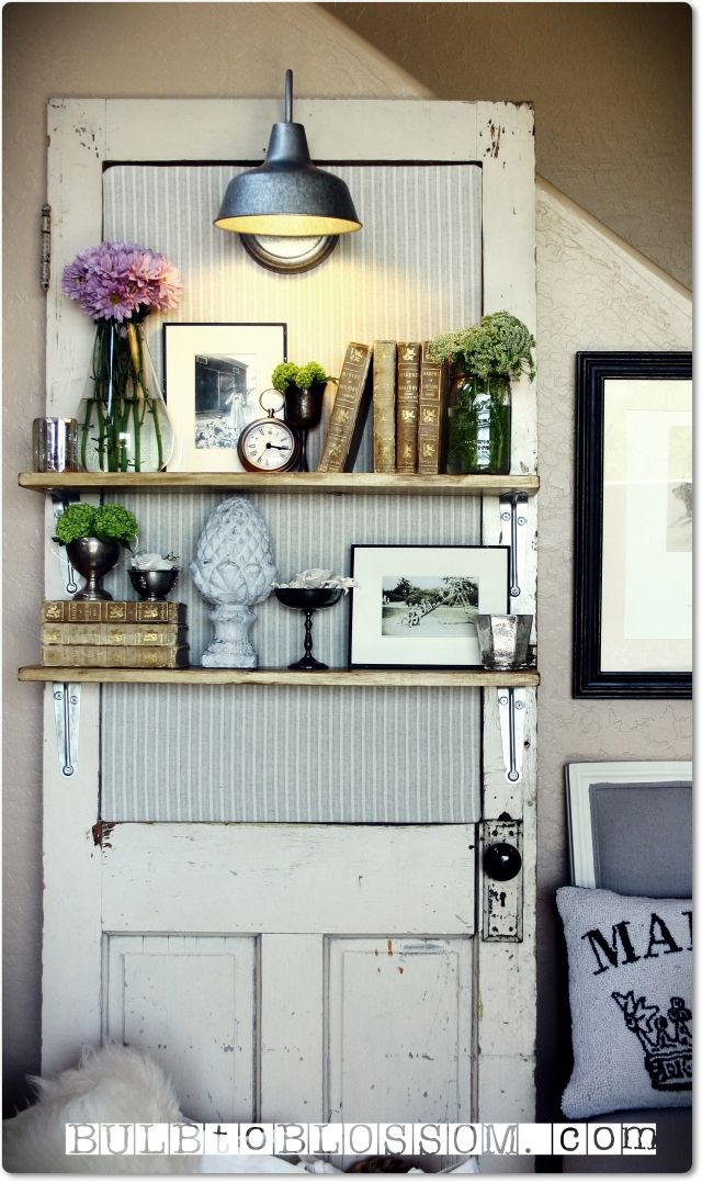 Turn an old door into decorative shelving.