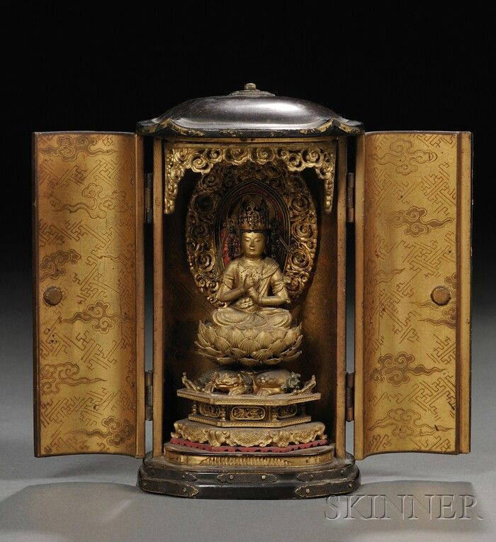 Zushi Shrine, Japan, Edo period, 19th century, double doors opening to a gilt-lacquered interior with a seated figure of Buddha atop an elaborate lotus stand, with a flame-like aureole to the back, cloud and brocade patterns to the inside of the doors, ht. 5 3/8 in.