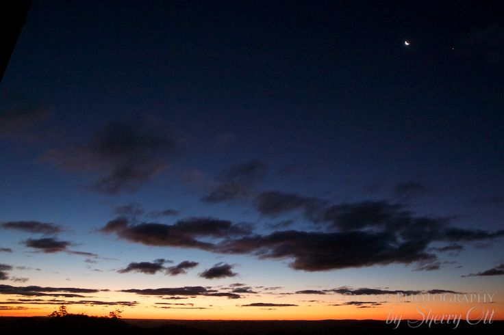 Sunset and a sliver of moon over Spicers Peak Queensland