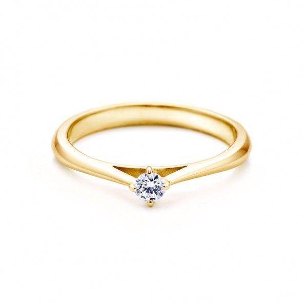 Pierścionek zaręczynowy z diamentem 0,05 ct o szlifie brylantowym wysokiej czystości SI1/G, wykonany z 18-karatowego żółtego złota. Zapraszamy na www.savicki.pl/kolekcje/the-light-pl