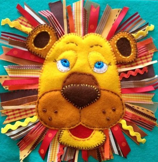 Quiet book page lion made with felt and ribbons.