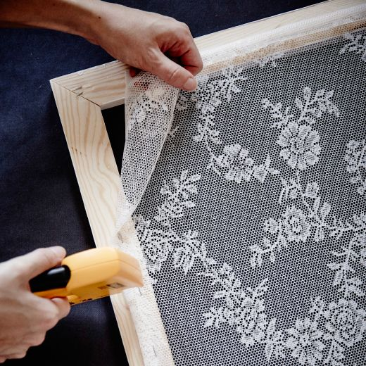 Make your lacy curtain frame by measuring out a wooden frame that fits the lower…