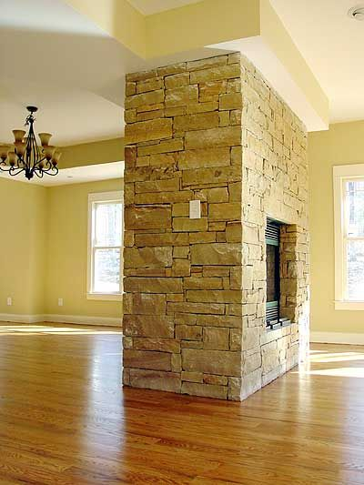 fireplace in the middle of dining and great room