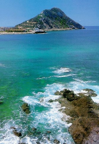Mazatlan, Mexico. There is a lighthouse at the top of that peak. Note the winding road up. Worlds highest lighthouse. Very tough hike!