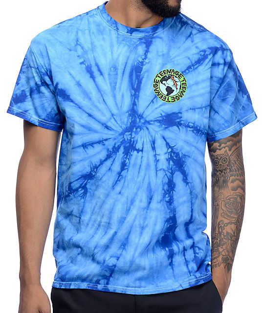 Get edgy style from Teenage with the Madness blue tie dye short sleeve t-shirt for guys that has a blue tie dye print and is finished with a logo graphic of the earth splitting printed at the left chest. Add jeans and fresh kicks for classic style.