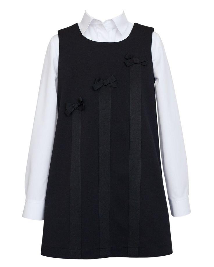 Sukienka idealna na szkolne uroczystości i wiele innych okazji. Klasyczny trapezowy krój wzbogacony ciekawymi ozdobnikami. Polecamy serdecznie! | Cena: 145,00 pln