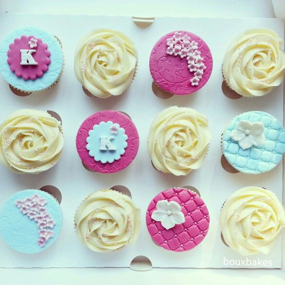 Pink and teal birthday cupcakes