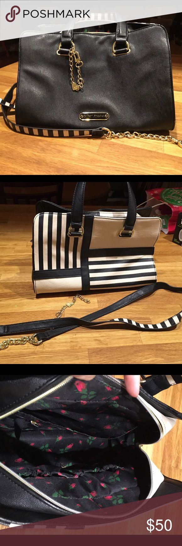 """Betsy Johnson satchel Cream and black poly Betsey Johnson satchel purse.  Has handles and removable strap with 4"""" gold chains at either end.  Long enough for cross-body.  Inside is black with red roses.  GUC.  13"""" wide X 8"""" tall X 8"""" deep.  Ask any questions.    Ask me any questions. Betsey Johnson Bags Satchels"""