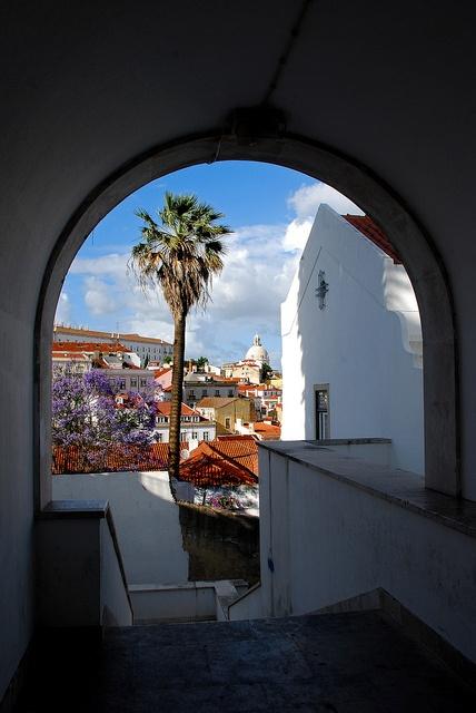 Alfama old neighborhood through an arch passway, Lisbon #Portugal
